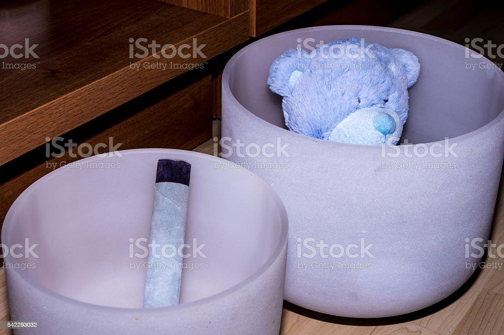 Teddy bear in a Tibetan Bowl stock photo
