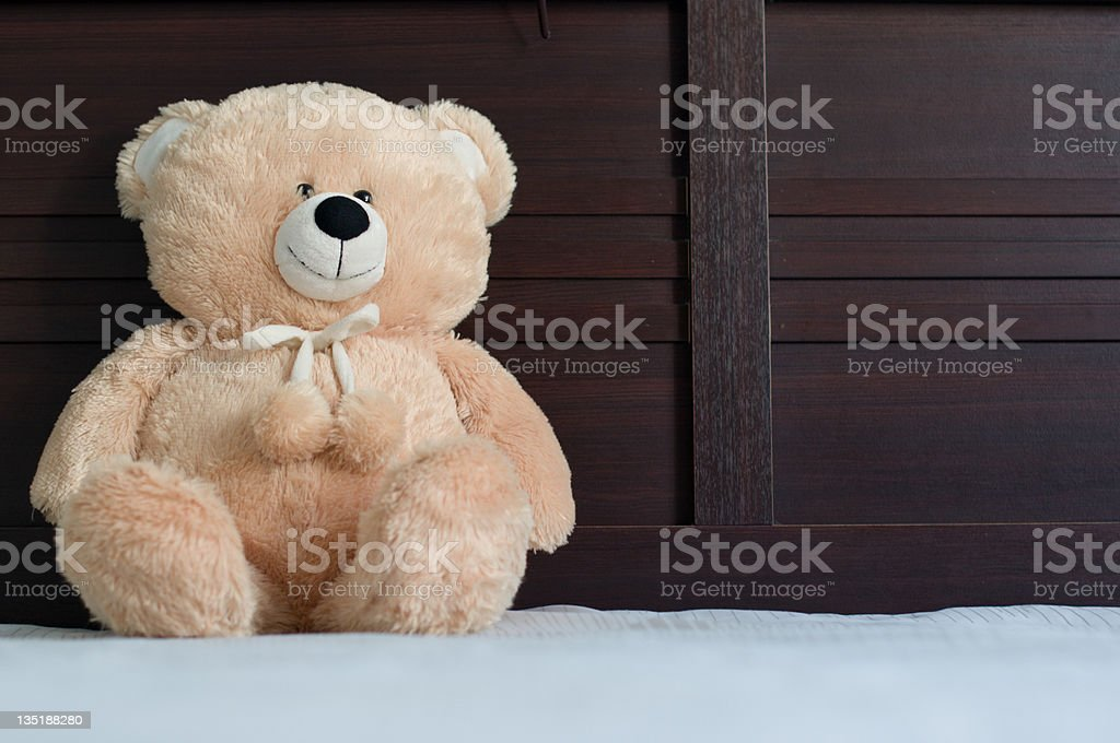 teddy bear in bed royalty-free stock photo