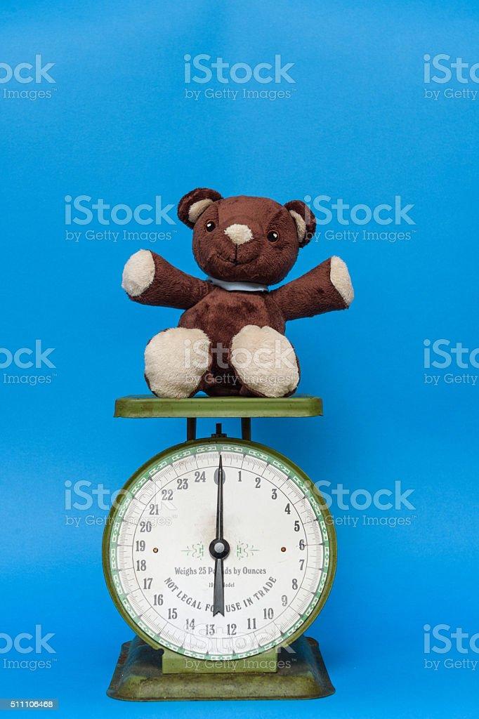 Teddy bear on an antique scale stock photo