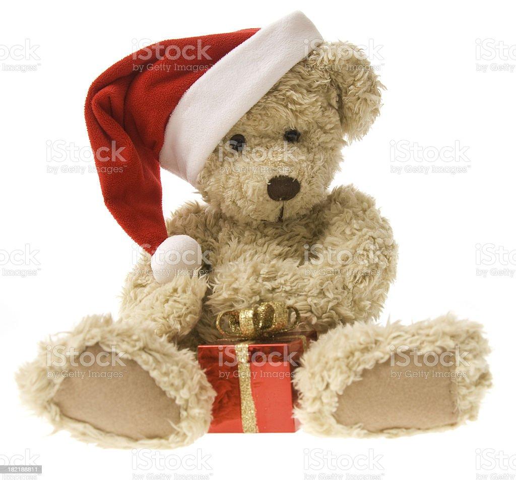 Teddy Bear Opening Christmas Gift royalty-free stock photo