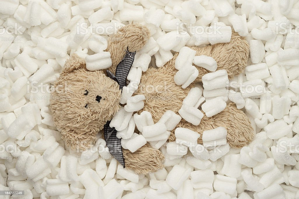 Teddy bear packing peanuts stock photo