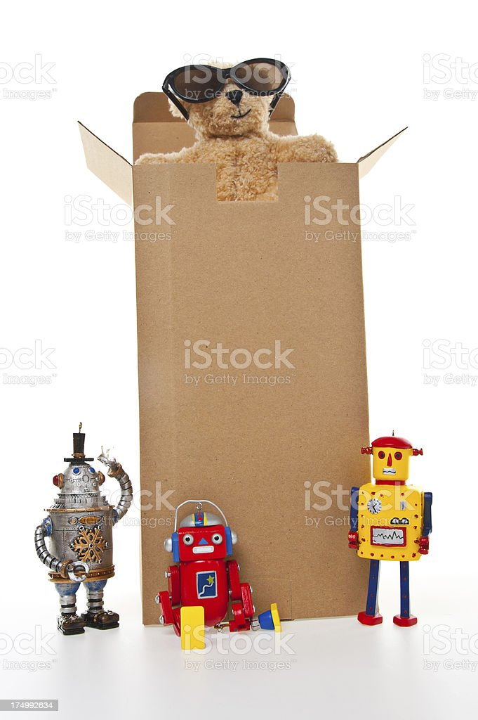 Teddy Bear, Robots and Toys in Cardboard Box royalty-free stock photo