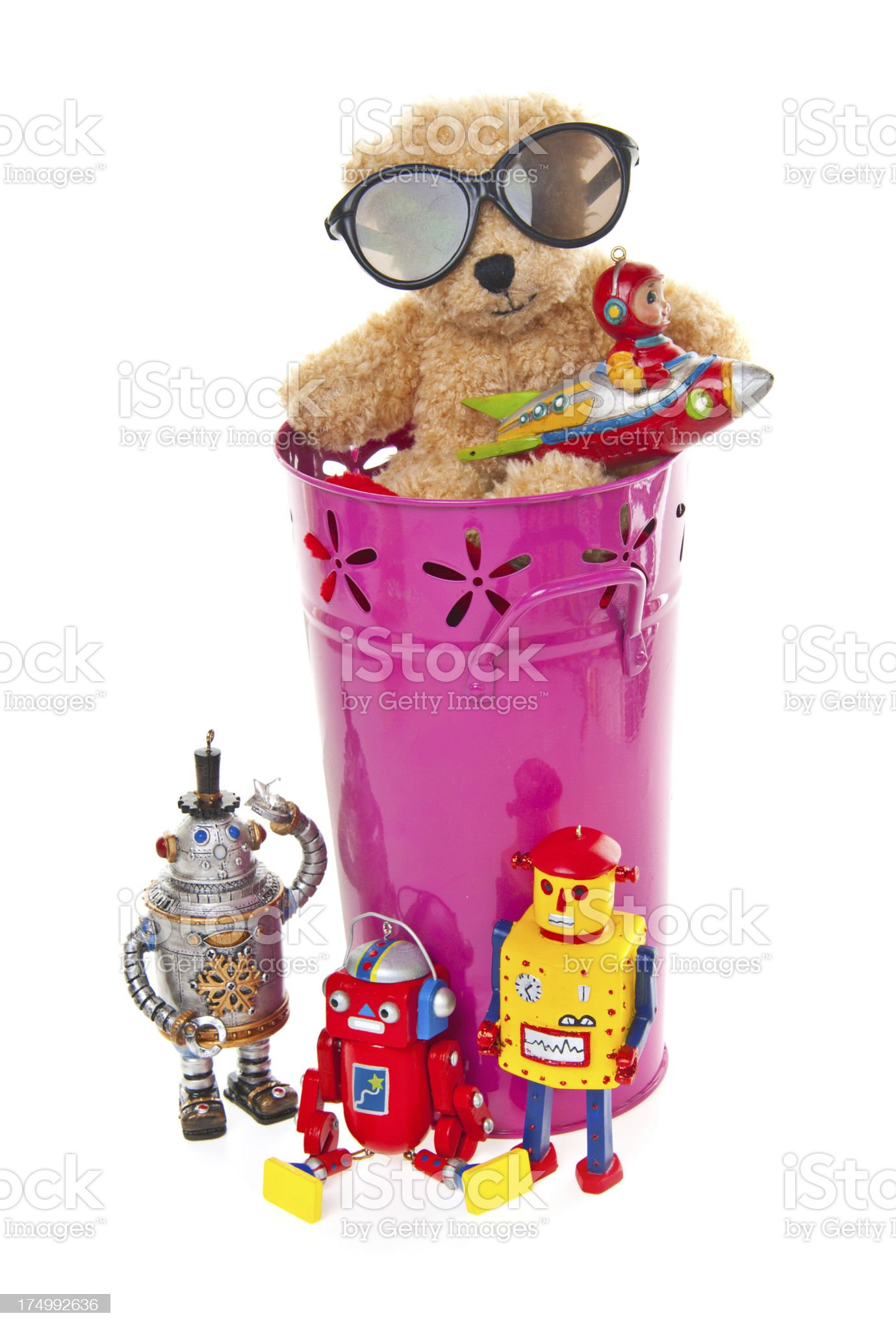 Teddy Bear, Robots and Toys in Pink Bucket royalty-free stock photo