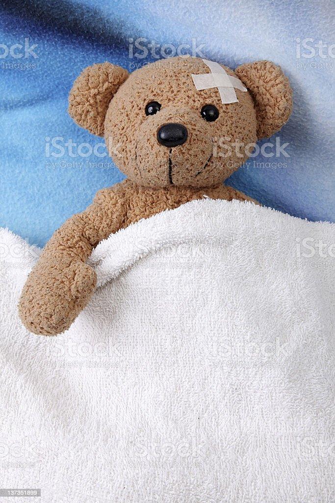 teddy bear sick stock photo