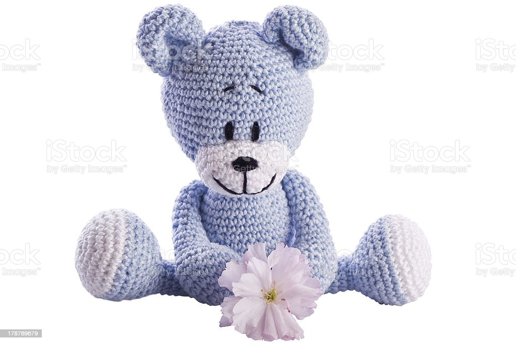 teddy bear stuffed animal with pink blossom royalty-free stock photo