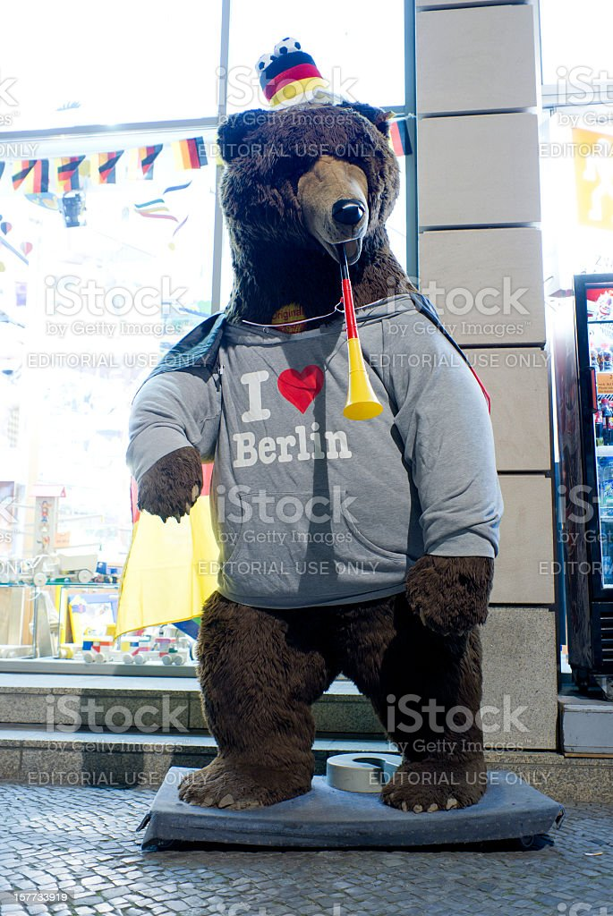 Teddy bear sweatshirt, hat and toy trumpet in German colors stock photo