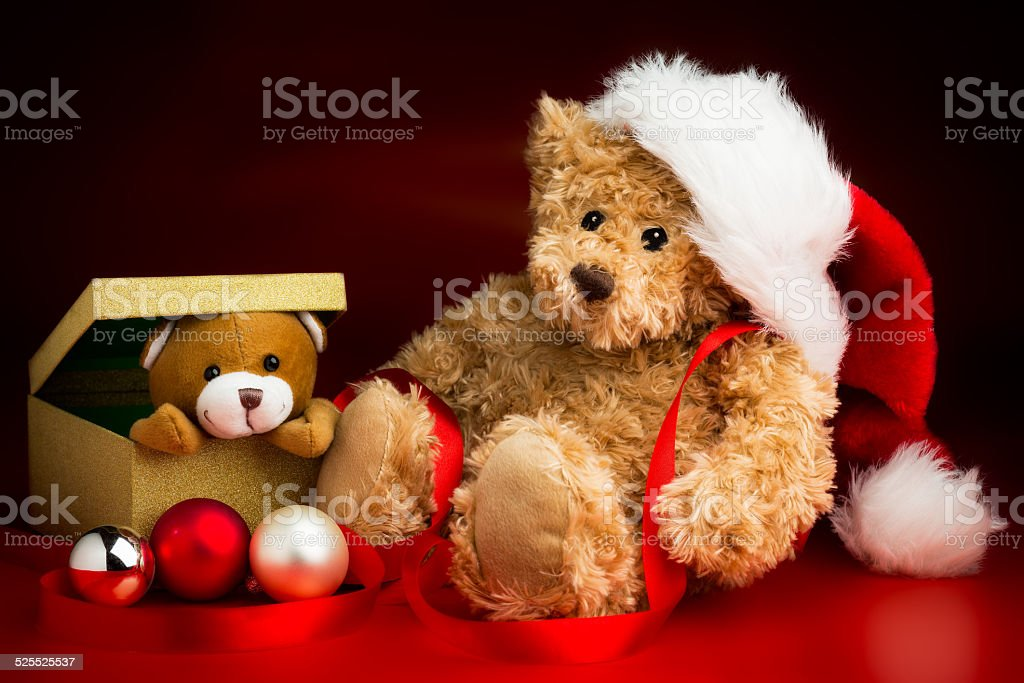 Teddy Bear Wearing a Christmas Hat and a Toy Friend stock photo