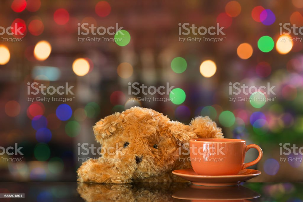 Teddy bear welcome at reception bar in coffee shop stock photo