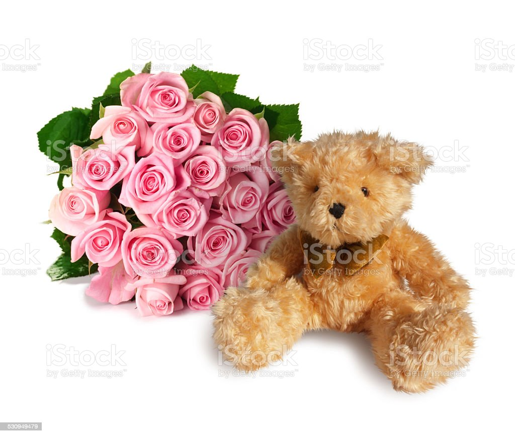 Teddy bear with a bouquet of pink roses