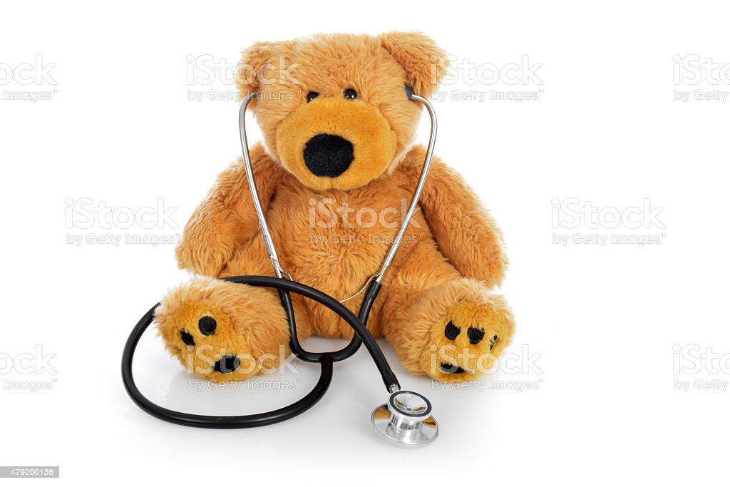 Teddy bear with a stethoscope on white background stock photo
