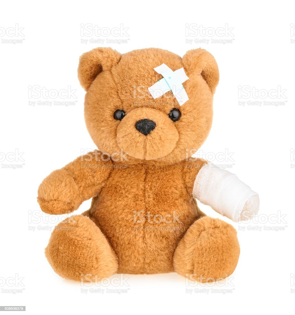 Teddy bear with bandage isolated on white stock photo