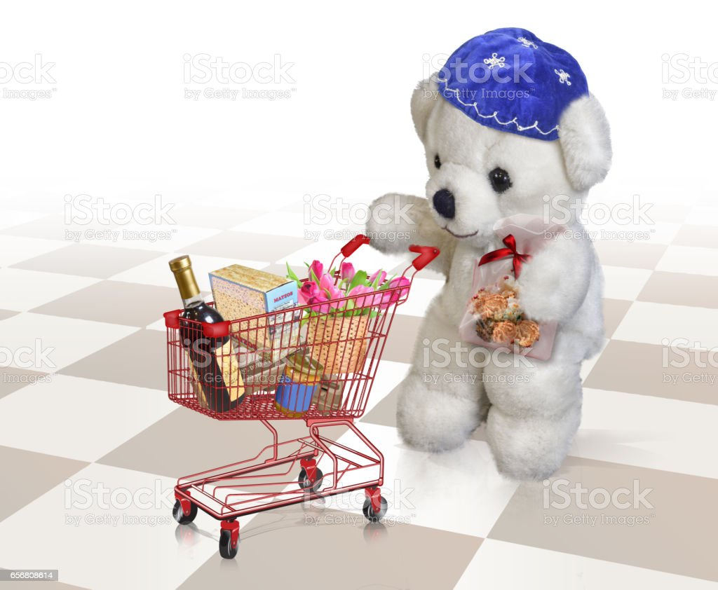 Teddy bear with Passover shopping cart stock photo