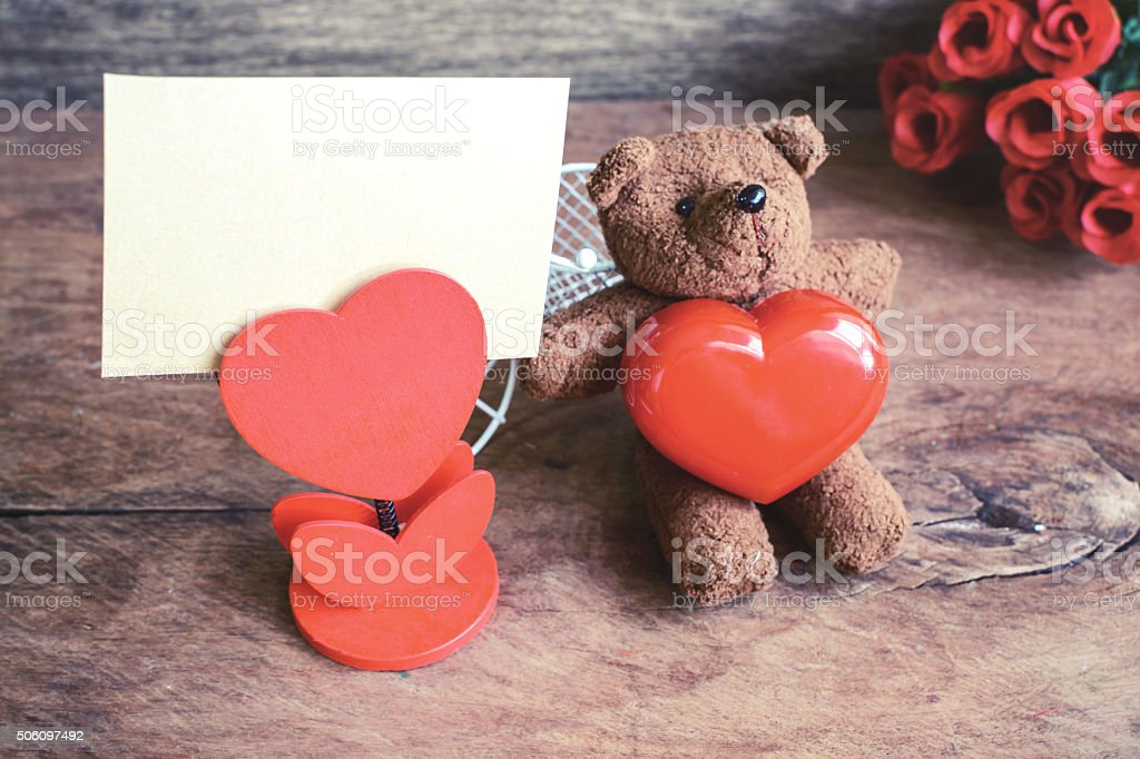 Teddy bear with red heart shape and notebook stock photo