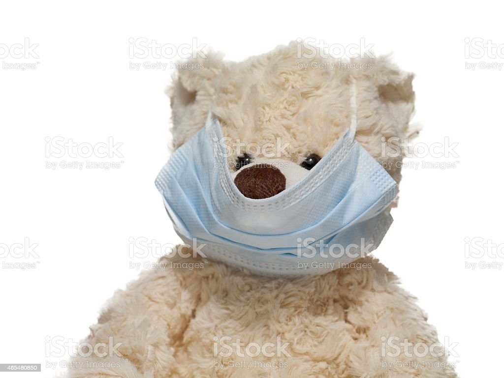 teddy bear with surgical mask stock photo