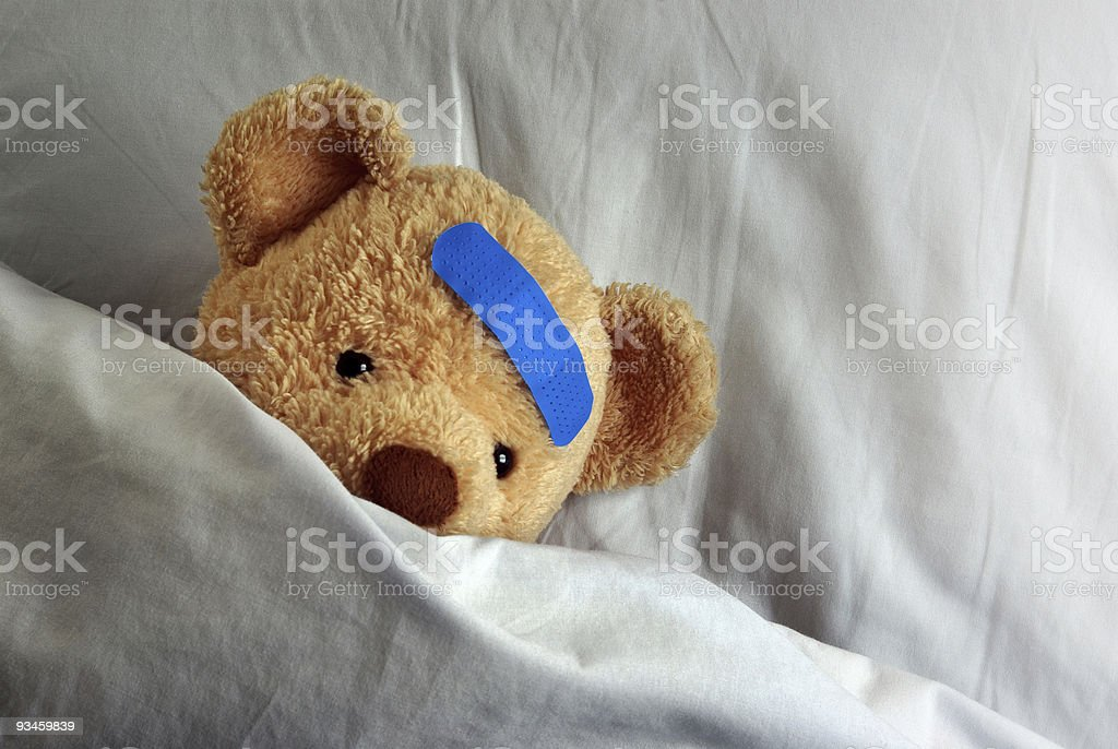 Teddybear in Bed stock photo