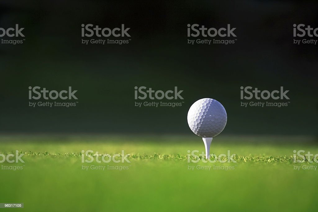 Tee and golfball on green stock photo