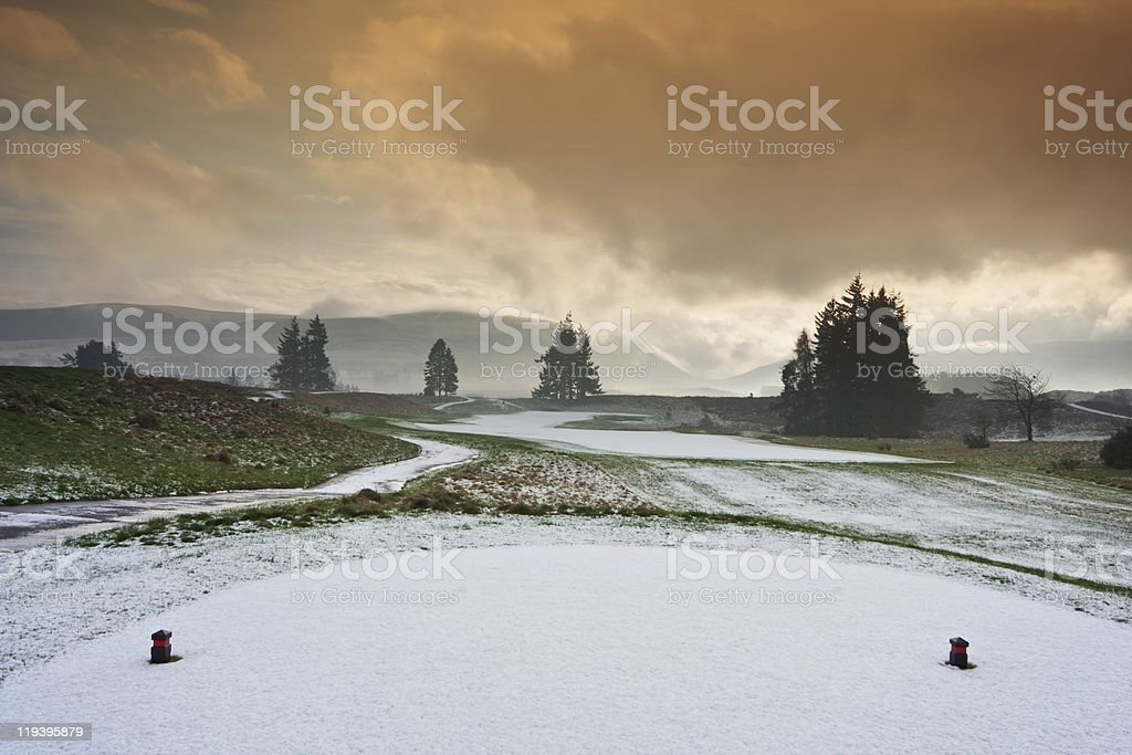 Tee on a snowy golf course royalty-free stock photo