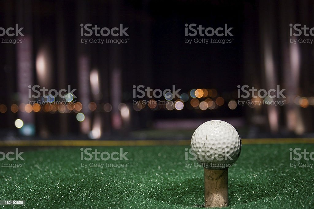 Tee Time at Night stock photo