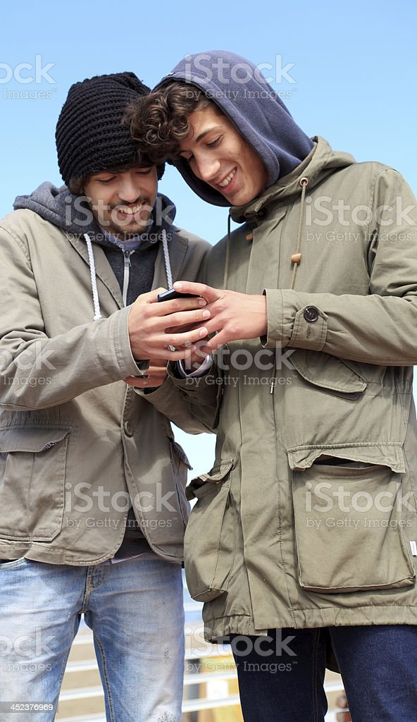 teeangers chatting with smartphone royalty-free stock photo