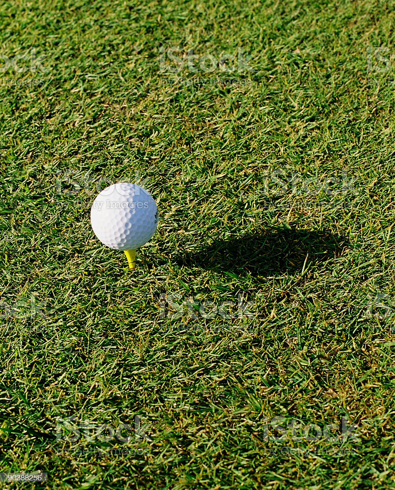 Teed golf ball and shadow royalty-free stock photo