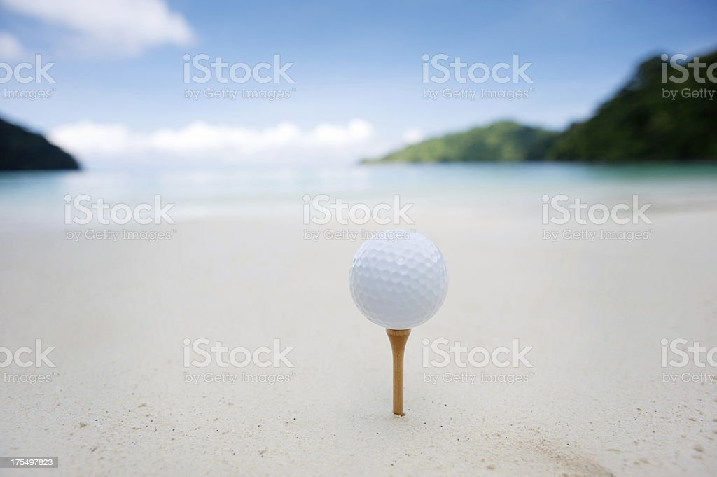 Teeing off on the beach royalty-free stock photo