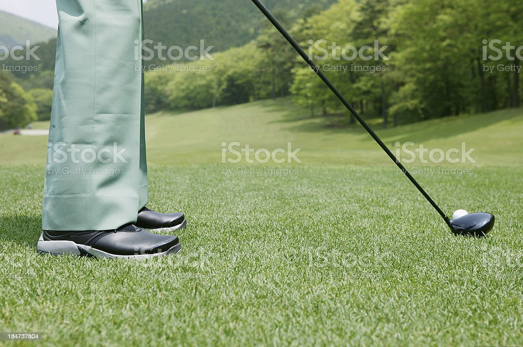Teeing off, side view royalty-free stock photo