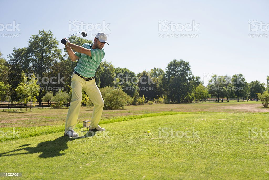 Teeing off with driver royalty-free stock photo