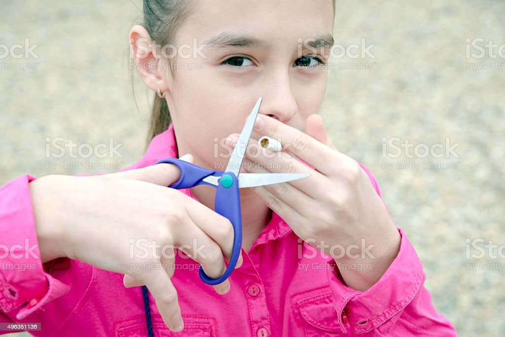 Teen Age Girl Discussed by Cigarets stock photo