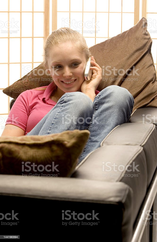teen age girl with cell phone knees up royalty-free stock photo