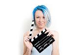 Teen alternative girl posing with movie clapper