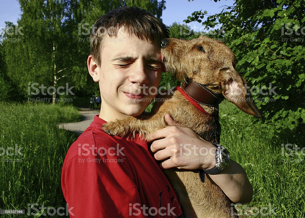 Teen and dog royalty-free stock photo