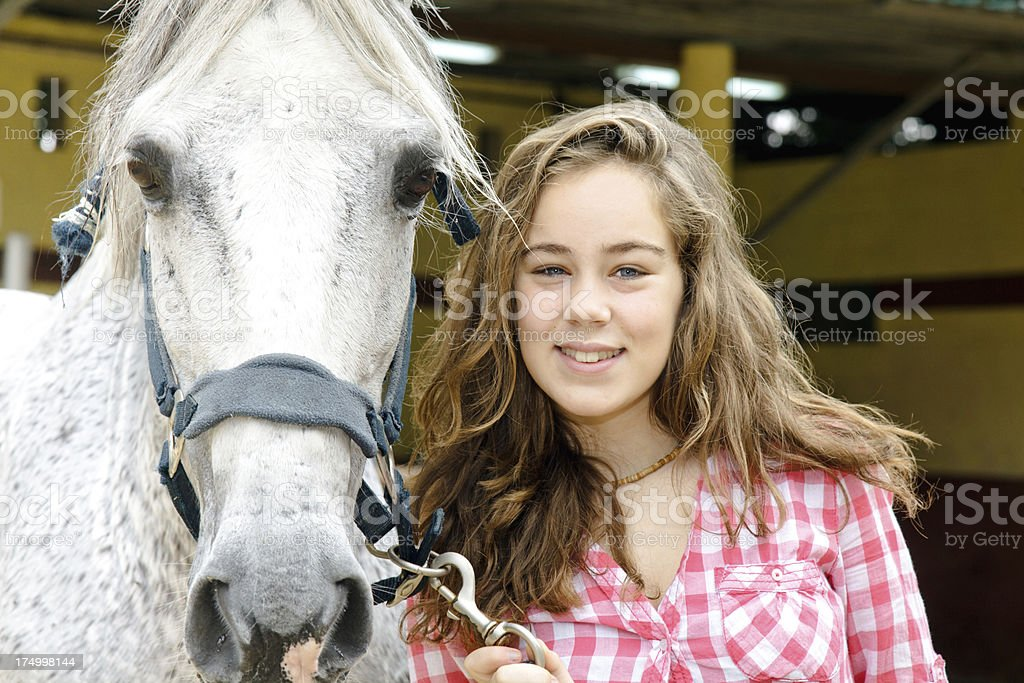 Teen and horse royalty-free stock photo
