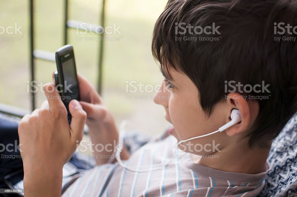 Teen and mobile phone royalty-free stock photo