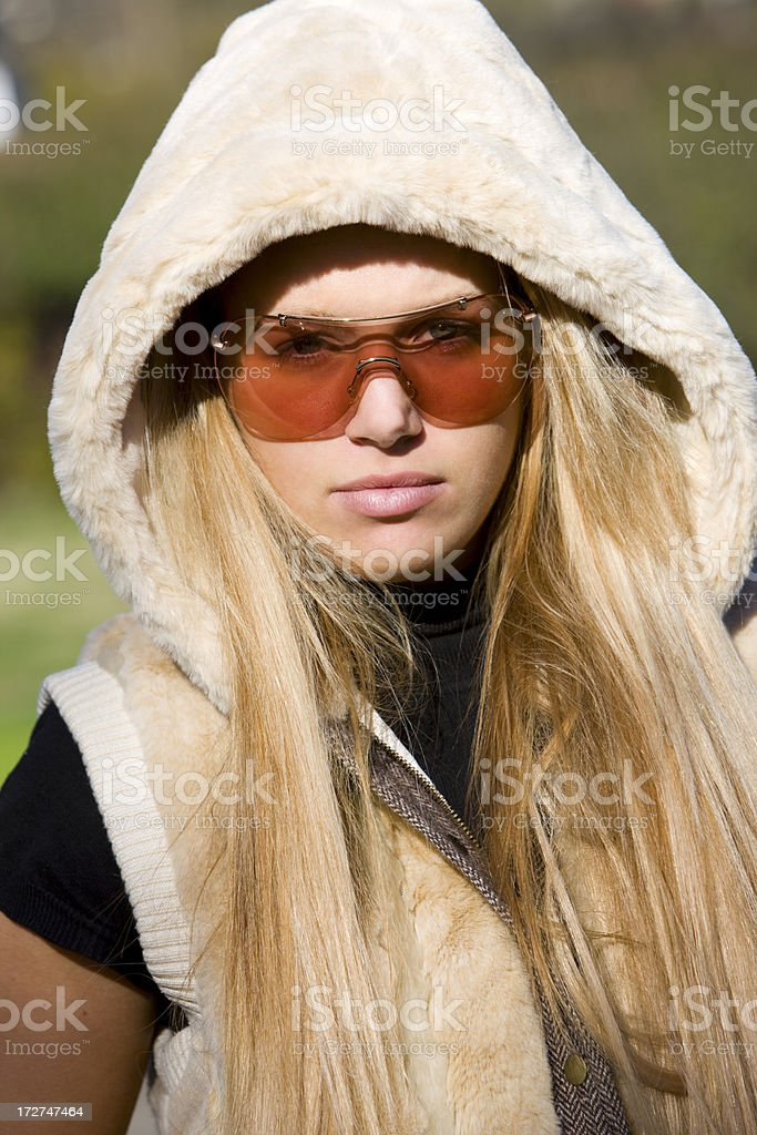 Beautiful Blond Young Woman Portrait Outdoors in Hooded Jacket, Sunglasses royalty-free stock photo