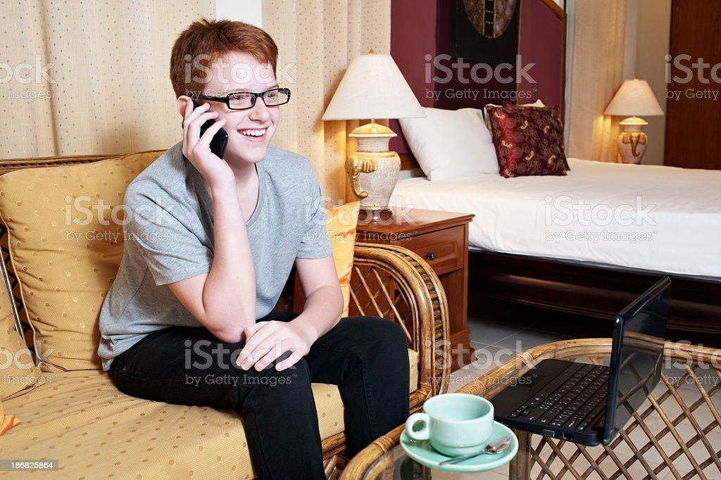 Teen Boy in Hotel Room royalty-free stock photo