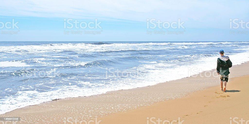teen boy on beach royalty-free stock photo