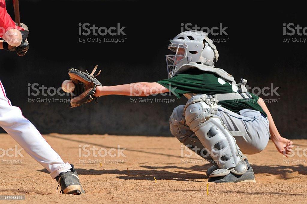 Teen boy plays baseball catcher stock photo