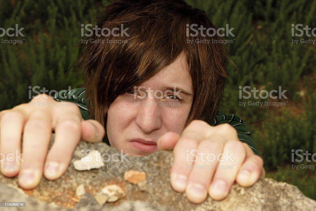 teen boy rock climbing royalty-free stock photo