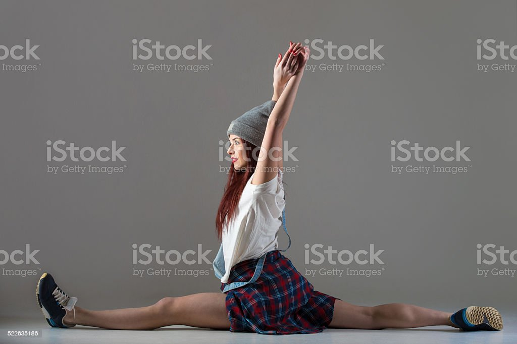 Teen breakdance girl sitting in splits stock photo