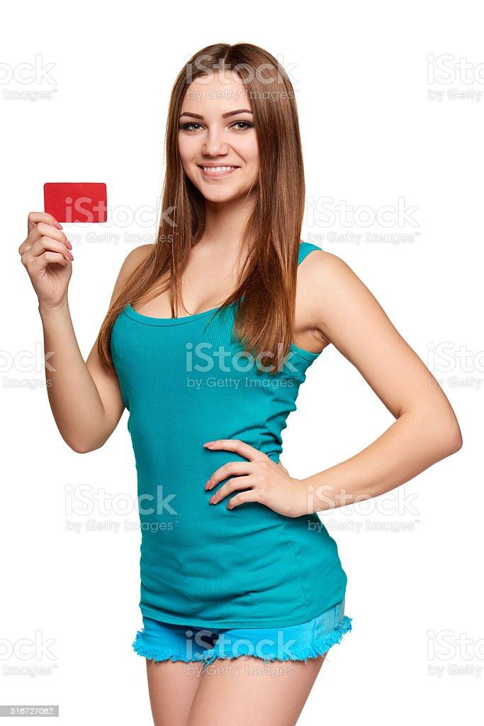 Teen bright girl holding credit card stock photo