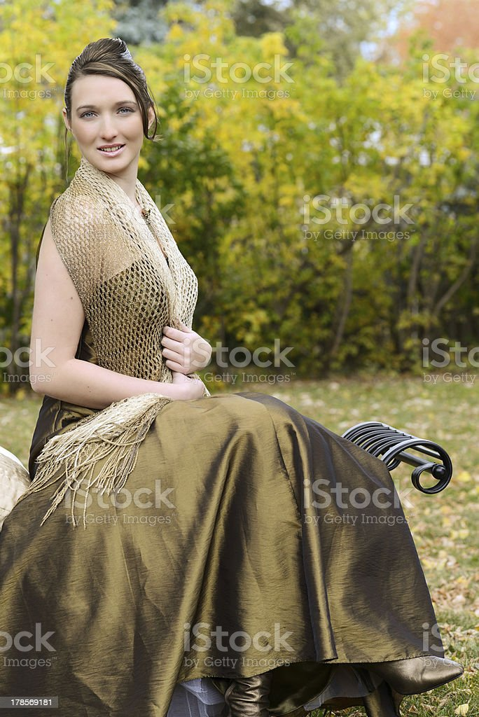 teen brunette portrait outside on a bench royalty-free stock photo