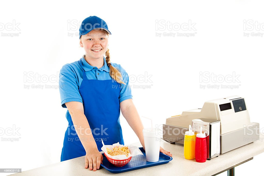 Teen Cashier Serves Fast Food stock photo