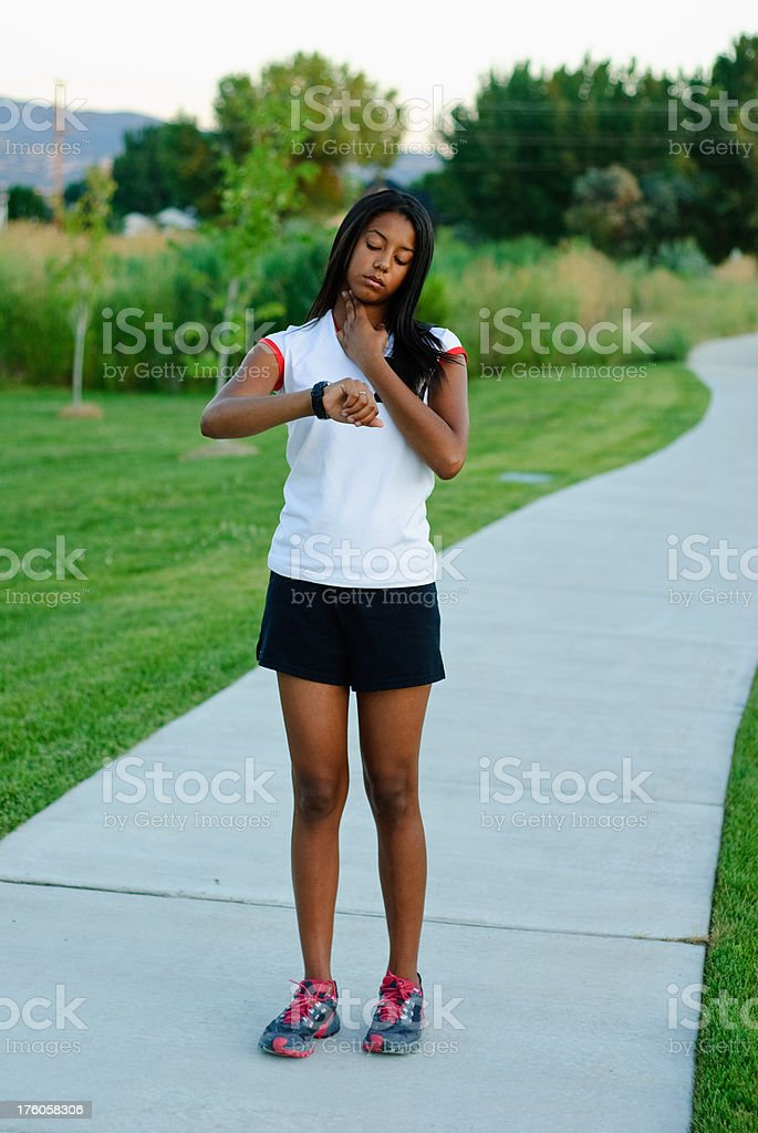 Teen checking pulse royalty-free stock photo