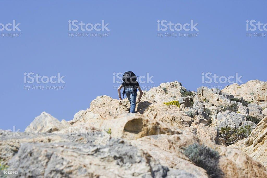 teen climbing a mountain royalty-free stock photo