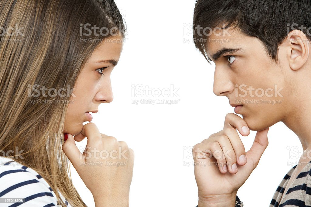 Teen coupe looking at each other wondering. stock photo