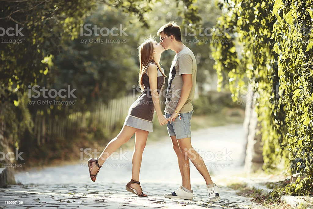 Teen couple together at street. stock photo