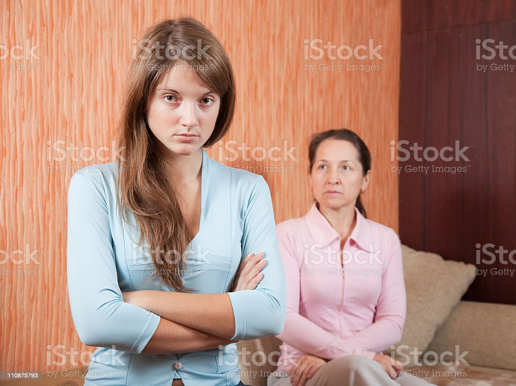 teen daughter and mother having quarrel stock photo