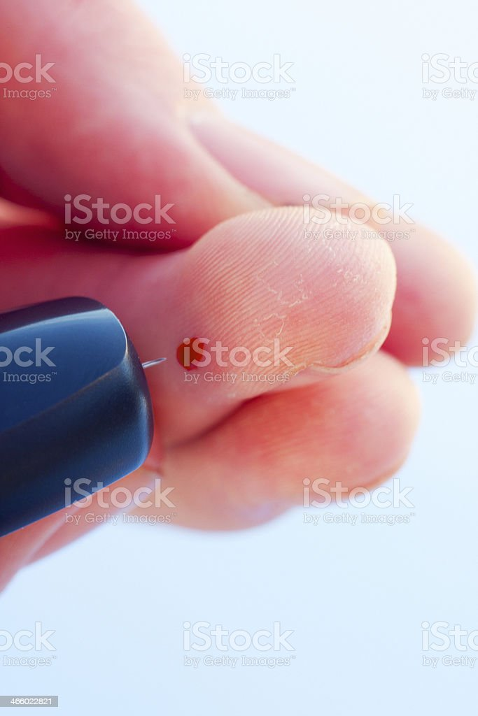 Teen Drawing Blood With Lancet royalty-free stock photo