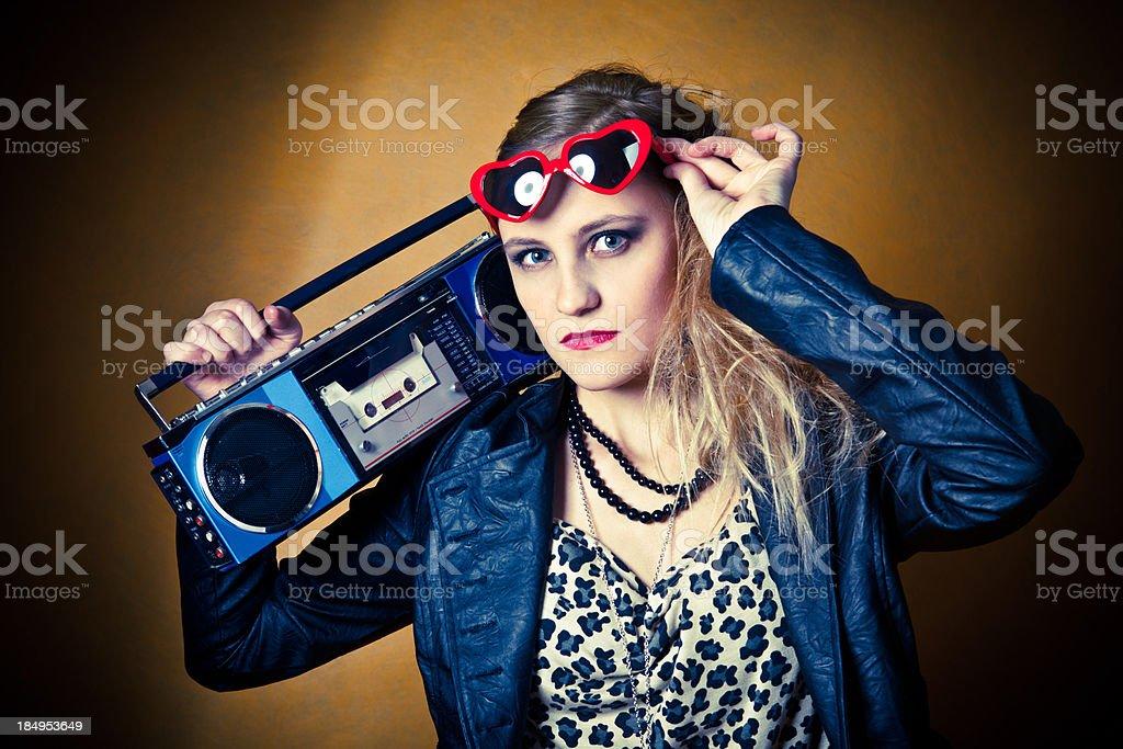 Teen Dressed in 80's Style Holding Boom Box Radio stock photo