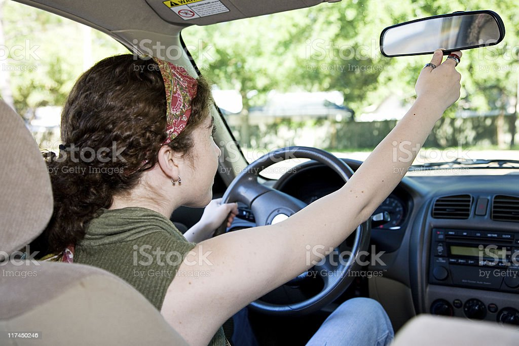 Teen Driver Adjusting Rearview Mirror royalty-free stock photo